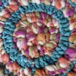 Colorful wool. Abstract multicolor texture background. Handmade crocheted pattern. Image of braided multi colored woollen yarns. Decorative mandala reproduction. — Stock Photo #78895788