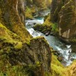 Aerial View Through Green Mountain River Canyon in Iceland. — Stock Video #78374406