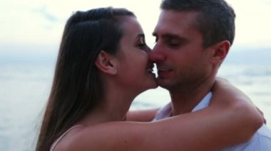 Young Couple Kissing on Beach — Stock Video