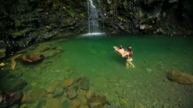 Couple Swims To Waterfall — Stock Video