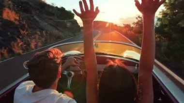 Happy Couple Driving Classic Convertible Car into Sunset on Country Road — Stock Video