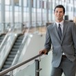 Business man professional portrait pose traveling for work at the airport station confident and successful expression — Stock Photo #78083752