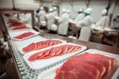 Pork chops at handling factory packaging plant raw organic — Stock Photo