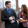 Lifestyle coworkers communicating together on a work break socializing attractive single professionals love laughter — Stock Photo #78844182