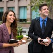 Playful fun laughing lifestyle of business executive persons work day coffee outdoors — Stock Photo #78844714
