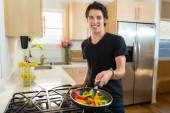 Cooking a nutritional low calorie vegetable meal new modern vegan man — Stock Photo