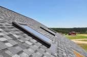 Beautiful roof windows and skylights — Stock Photo