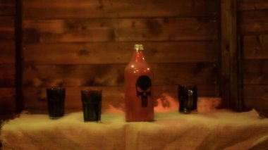 Magic spells in antique bottles over black background and smoke — Stock Video