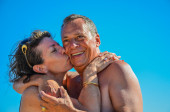 Kiss of love in the blue sky — Stock Photo
