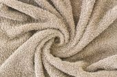 Roll brown spa towels background — Stock Photo