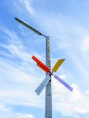 Turbine and lamp with blue sky — Stock Photo