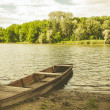 Summer landscape: a chained boat on the shore, a backwater and a forest. — Stock Photo #83270002