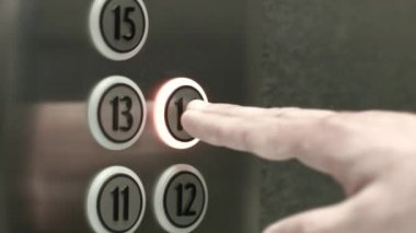 Man presses a button the fourteenth floor in an elevator — Stock Video