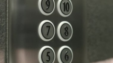 Man presses a button the seventh floor in an elevator — Stock Video