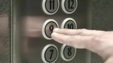 Man presses a button the ninth floor in an elevator — Stock Video
