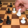 Playing chess. Move by knight. — Stock Photo #79056596