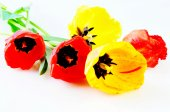Three red and two yellow tulips — Stock Photo