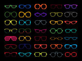 Vector set of colored glasses. Retro, geek, hipster frames. — Stock Vector
