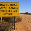 Gravel Road Careful Driving Sign — Stock Photo #78314910