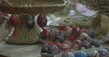 Woman Hangs Painted Easter Eggs On Wicker Stand Still Life Of Easter Eggs Girls Draw On Easter Eggs Technology Of Painting On Easter Egg — Stock Video
