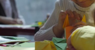 Paper Origami Kids Make Origami From Colored Paper Origami Contest Making Of Kusudama Assemble Of Modular Origami Unit Origami Close View Indoors — Stock Video