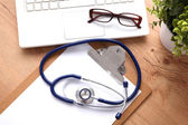 Stethoscope on laptop keyboard. Concept 3D image — Stock Photo