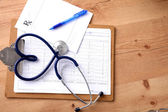 Stethoscope in the shape of a heart on the table. Concept 3D image — Stock Photo