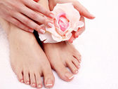 Beautiful feet with perfect spa french nail pedicure — Stock Photo