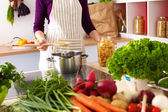 Young Woman Cooking in the kitchen. Healthy Food — Stock Photo