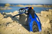 Vacation Start Here Concept, Scuba Diving Equipment On The White Sea Sand Beach with Crystal Clear Sea and Sky in Background used as Template.Blue flippers and swimming mask — Stock Photo