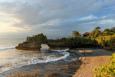 Large rock formation extending into the ocean in Bali — Stock Photo