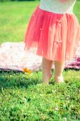 Baby feet on the grass — Stock Photo