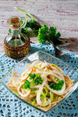 Salad and pepper squid with onions — Stock Photo