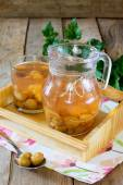 Gooseberry compote in a jar on a wooden tray — Stock Photo