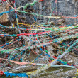 Colorful Buddhist prayer flags are waving above the Tibetan river — Stock Photo #78542256