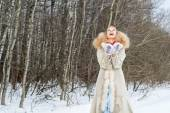 Sincerely laughing young woman in a winter forest — Stock Photo