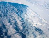 Aerial view of the Greenland cloudy coastline — Stock Photo