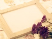Blank wood frame and bouquet of chrysanthemums with vintage filters color — Stock Photo