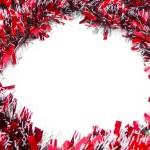 Red Christmas tinsel garland — Stock Photo #79090680