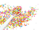 Colorful sugar pearls in white spoon — Stock Photo