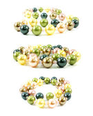 Pastel colored bead and pearls on a white background — Stock Photo