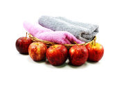 Apple and towel on isolated background — Stock Photo