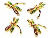 Dragonfly jewellry brooch isolated on black background — Stock Photo