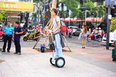Hochiminh City, Vietnam - July 8, 2015: Man riding a Segway electric vehicle two wheels on a young tour sightseeing gyropode on Walking Street Nguyen Hue Street, HoChiMinh city center — Stock Photo