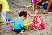 Ho Chi Minh City, Vietnam - June 21, 2015: Unknown children playing in the sand in a park in Ho Chi Minh City, Vietnam — Stock Photo