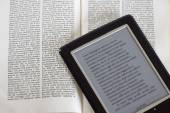 Ebook reader and book — Stock Photo