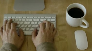 Typing at Light Wooden Desk at Laptop whis individual habits — Stock Video