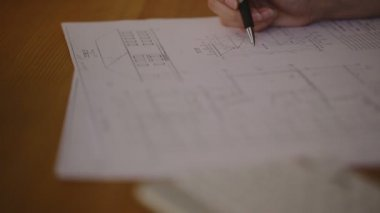 Hands Young female architect working on blueprint — Stock Video
