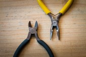 Old pliers and wirecutters on the wood — Stock Photo