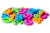 Colorful magnetic digits on refrigerator — Stock Photo